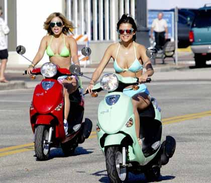 March 13, 2012: Selena Gomez, Vanessa Hudgens, Ashley Benson and Rachel Korine are seen riding scooters on the set of 'Spring Breakers' filming in St. Petersburg, FL. Pictured here: Selena Gomez, Vanessa Hudgens. Mandatory Credit: INFphoto.com Ref: infusmi-13